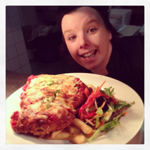 Tameka with our famous Nichols Free Range Tasmanian Chicken Parma!